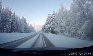 Finnish dashcam shows tranquil winter landscape beyond the Arctic Circle