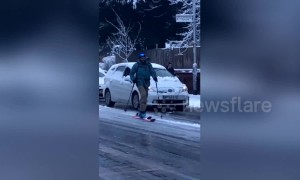 Manchester man skis past gridlock caused by icy roads