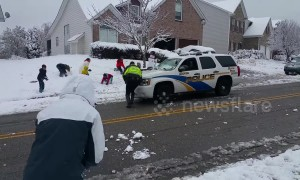 Friendly police join in snowball fight with neighbourhood kids