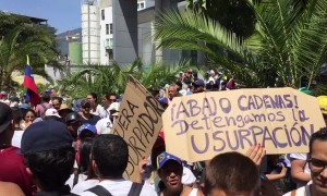 Tens of thousands march in Venezuela to force Maduro from power