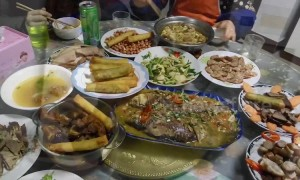 Chinese man shows off sumptuous family feast on Lunar New Year's Eve