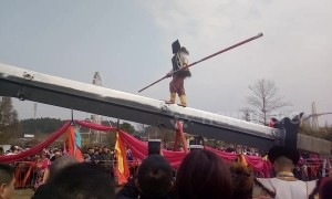 Kung fu master walks and does balance tricks on giant knife-edge