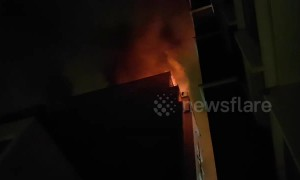 Moment firefighters attempt to enter burning Paris apartment block