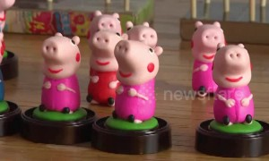 Folk artists make Peppa Pig toys out of dough for the Year of the Pig