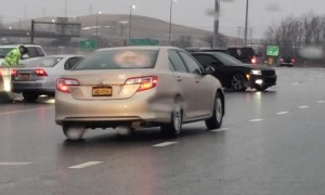 Icy Weather Causes Wrecks in the Rain