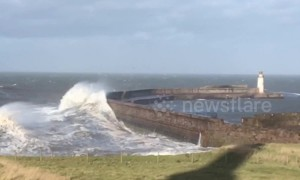 Huge waves surge over Whitehaven sea walls