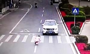 Polite girl bows to car driver after he stops to let her cross the road