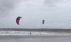 Kite surfers make most of gale-force winds in Cornwall, UK