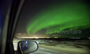 Car passenger films spectacular aurora display in Iceland