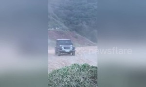 Hardtop Jeep turns into instant convertible after jump fail
