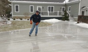 Who says the polar vortex isn't fun? Man skates on his frozen driveway