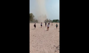 Children flee as mini tornado whips through school field in Thailand