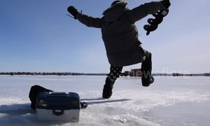 This is the moment an ice fisherman finds out ice is slippery