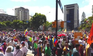 Thousands of Venezuelans march in Caracas to demand humanitarian aid be allowed to enter country