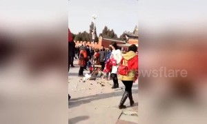 Chinese urban management officer violently smashes old vendor's cart