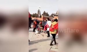 Chinese urban management officer violently smashes old vendor's cart