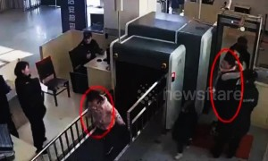 Naughty girl climbs through X-ray machine at train station