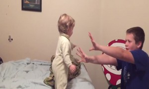 Silly Siblings Pretend to Knock over Baby