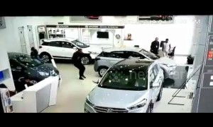 Customer smashes through car showroom window at dealership in India