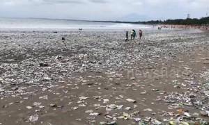 Shocking footage of Bali beach swamped by plastic waste
