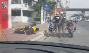 Thai police make young men do press-ups instead of paying traffic fine