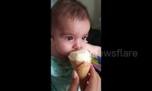 Hungry Aussie baby instantly calms down when eating ice-cream