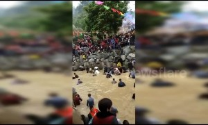 Thousands catch fish with bare hands at annual festival in China's Fujian