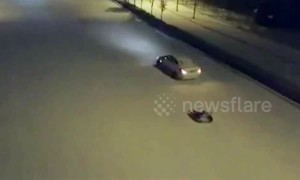 Girl riding tyre gets dragged along snowy road by her father in car in China's Henan