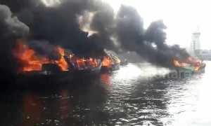 Fishing fleet completely destroyed in harbour fire in Indonesia