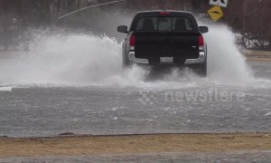 Ontario's main roads swallowed by fast moving rivers during storm surge