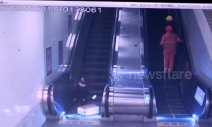 Runaway suitcase knocks down woman on escalator in eastern China