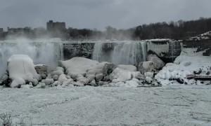 Broken ice from Lake Erie partially blocks Niagara Falls