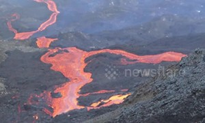 Brave hiker captures rivers of lava erupting from volcano on French-controlled island