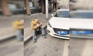 Old Chinese man runs towards parked car and pretends to be hit by it in attempted scam