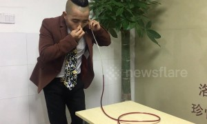 Chinese man is able to drink red wine from glass through his EARS