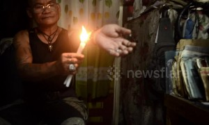 Filipino man coats arm in hot wax in bizarre ritual
