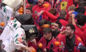 Food fight! Italians beat the pulp out of each other in annual Battle of the Oranges carnival
