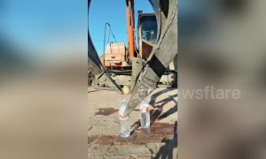 Smooth operator! Digger driver shows off his precision machinery control