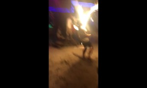 Man stacks it after tripping on flaming skipping rope