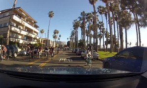 Large Group of Cyclists Swarm Car