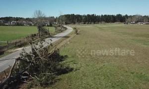 Trees felled, buildings destroyed after Alabama tornado leaves 23 dead