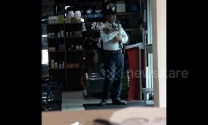 Awwwww! Filipino security guard rocks troubled puppy to sleep