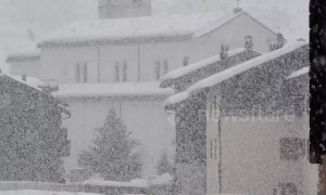 Dense snow nearly whites out northern Italy town