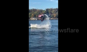 Jet skier makes a splash with a double flip during stunt jump attempt