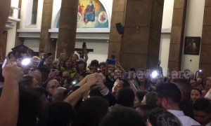 Venezuelans show support for Guaido in church after return to country