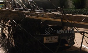 Driver has lucky escape after electricity post falls on his car