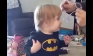 Toddler's reaction after clearly seeing parents for first time with glasses