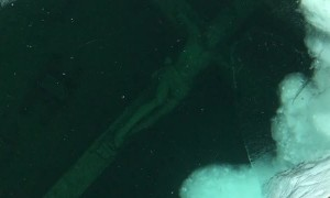 Icy Underwater Crucifix