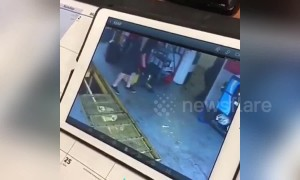 Man falls backwards into garage inspection pit