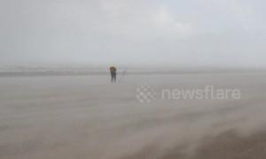 Dramatic moment storm hits Northern Ireland coast, leaving beach-goers battling horizontal hail and sand